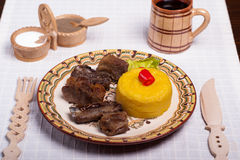 Meat with polenta on the wood with re wine Stock Photography