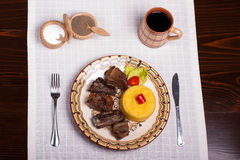 Meat with polenta on the wood with re wine Royalty Free Stock Image