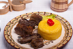 Meat with polenta on the wood with re wine Royalty Free Stock Photos