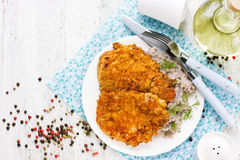 Meat pork chop in bread crumbs garnished with green buckwheat, h Stock Photos