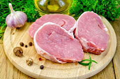 Meat pork slices on a board with nutmeg Stock Photos