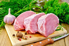 Meat pork slices on a board with oil Royalty Free Stock Photos