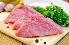 Meat pork slices on a board Royalty Free Stock Photography