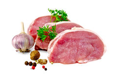 Meat pork slices with spices and garlic Stock Image