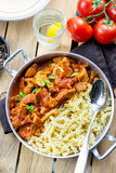 Meat pork in thick tomato gravy with pasta Royalty Free Stock Photography