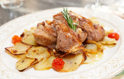 Meat and potato fried in oven Stock Images