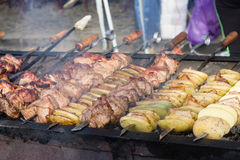 Meat and potato on grill Royalty Free Stock Photo