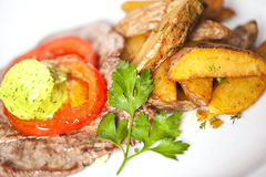 Meat and potato slices with butter Stock Images