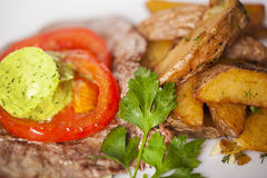 Meat and potato slices with butter Royalty Free Stock Images