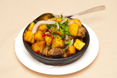 Meat with potatoes Stock Images