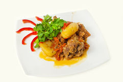 Meat with potatoes, against white background Royalty Free Stock Images