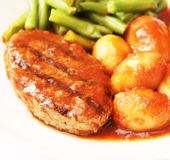 Meat with potatoes and beans Stock Images