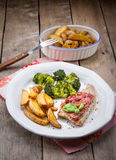 Meat with potatoes and broccoli. Roasted meat with potatoes and broccoli Stock Image