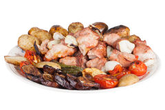 Meat with potatoes, eggplants, tomatoes, onions and peppers on t Royalty Free Stock Photo