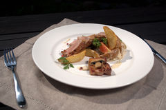 Meat with potatoes and meadow mushroom. Serve outdoor royalty free stock photography