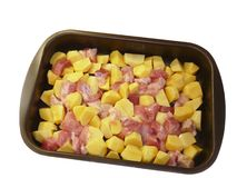 Meat and potatoes in trays, isolated Stock Image