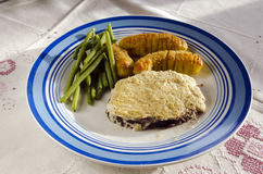 Meat and potatos. Moose steak with cheese on top and potatos andn haricots verts Stock Images