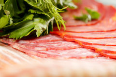 Meat products and greens Stock Photo