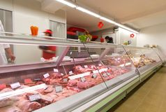 Meat products in grocery store. Meat products on a display in a grocery store or shop Stock Photos