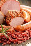 Meat products including ham and sausages Stock Photo
