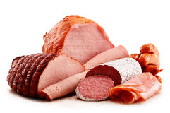 Meat products including ham and sausages on white Royalty Free Stock Photo