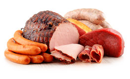 Meat products including ham and sausages on white Stock Photography