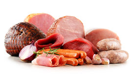 Meat products including ham and sausages on white Royalty Free Stock Photography