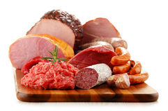 Meat products including ham and sausages on white Stock Photos