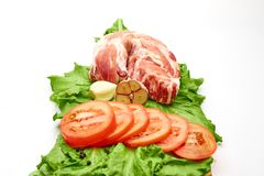 A piece of pork and tomatoes stock photos