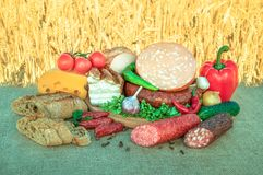 Meat products.Smoked ham,sausage,bacon,vegetables Stock Photos