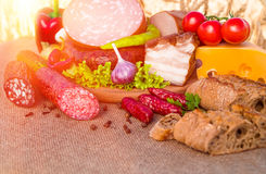 Meat products.Smoked ham,sausage,bacon,vegetables Stock Photo