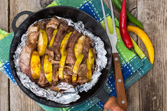 Meat with quince baking in foil in the oven Royalty Free Stock Photos