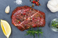 Meat raw beef steak from above slate. Top view royalty free stock photography