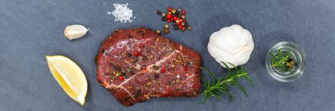 Meat raw beef steak banner from above slate. Top view stock photo