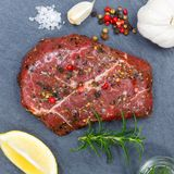 Meat raw beef steak square from above slate. Top view stock image