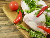 Meat raw chicken leg greens, red chili pepper, nutrition tomato Royalty Free Stock Photos