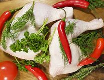 Meat raw chicken leg greens, red chili pepper, tomato Stock Image