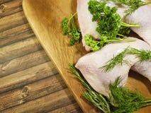 Meat raw chicken leg greens. Wooden Stock Photo