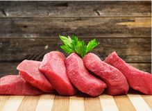 Raw Meat slices on background. Meat raw slices group background market shop Royalty Free Stock Photo