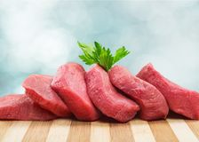 Raw Meat slices on light background. Meat raw slices group background market shop Royalty Free Stock Photography