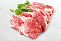 Raw Meat slices on light background. Meat raw slices group background market shop Stock Photography