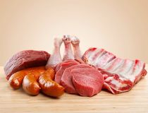 Raw Meat slices on wooden background. Meat raw slices group background market shop Royalty Free Stock Images