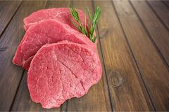 Raw Meat slices on wooden background. Meat raw slices group background market shop Royalty Free Stock Photography