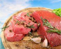 Raw Meat slices on wooden background. Meat raw slices group background market shop Stock Photos