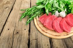 Raw Meat slices on wooden background. Meat raw slices group background market shop Stock Image