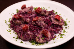 Meat with red cabbage and crandberry Stock Images