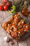 Meat in red marinade with spices, thyme, garlic and chilli in a. Bowl close up. vertical Royalty Free Stock Image