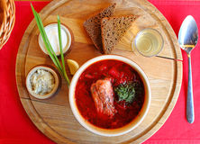 Meat red soup with herbs in the supply of onions. And garlic bread Royalty Free Stock Images