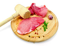 Meat repulsed with wooden mallet Stock Image
