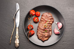 Meat Ribeye steak entrecote with baked tomatoes Stock Photo